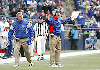 New York Giants head coach Tom Coughlin raised his arms up in the air in frustration after his offense of unit was flagged for back to back false starts against the Seattle Seahawks during the second quarter at Quest Field in Seattle, WA.