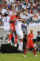 Felipe Baloy (23) of Panama (PAN) battles Brian Ching (11) and Davy Arnaud (22) of the United States (USA) for a header. The United States (USA) defeated Panama (PAN) 2-1 during a quarterfinal match of the CONCACAF Gold Cup at Lincoln Financial Field in Philadelphia, PA, on July 18, 2009.