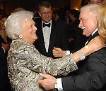 First Lady Barbara Bush greets Lech Walesa at the Leading Hearts Gala VIP Reception at the Skyline Ballroom at the Hilton Americas downtown Saturday Oct. 24,2009. (Dave Rossman/For the Chronicle)