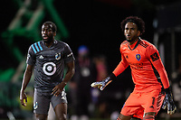 LAKE BUENA VISTA, FL - AUGUST 06: Kevin Molino #7 of Minnesota United FC and Pedro Gallese #1 of Orlando City SC battle for the ball during a game between Orlando City SC and Minnesota United FC at ESPN Wide World of Sports on August 06, 2020 in Lake Buena Vista, Florida.