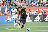FOXBOROUGH, MA - AUGUST 3: Carlos Vela #10 of Los Angeles FC with Luis Caicedo #27 of New England Revolution in pursuit during a game between Los Angeles FC and New England Revolution at Gillette Stadium on August 3, 2019 in Foxborough, Massachusetts.