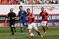 Jason Pearce of Charlton passes the ball upfield during Charlton Athletic vs Wigan Athletic, Sky Bet EFL Championship Football at The Valley on 18th July 2020