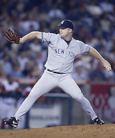 Mike Stanton of the New York Yankees pitches during a 2002 MLB season game against the Los Angeles Angels at Angel Stadium, in Anaheim, California. (Larry Goren/Four Seam Images)