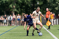 NEWTON, MA - SEPTEMBER 12: Emily Knous #10 of Boston College dribbles as Sydney Baldwin #4 of Holy Cross defends during a game between Holy Cross and Boston College at Newton Campus Soccer Field on September 12, 2021 in Newton, Massachusetts.