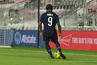 FORT LAUDERDALE, FL - DECEMBER 09: Ayo Akinola #9 of the United States passes the ball during a game between El Salvador and USMNT at Inter Miami CF Stadium on December 09, 2020 in Fort Lauderdale, Florida.