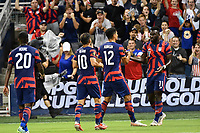 KANSAS CITY, KS - JULY 15: Christian Roldan #10 ,Miles Robinson #12 and Daryl Dike #11 of the United States celebrate a goal during a game between Martinique and USMNT at Children's Mercy Park on July 15, 2021 in Kansas City, Kansas.