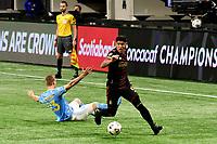 ATLANTA, GA - APRIL 27: Atlanta United defender #6 Alan Franco dribbles the ball during a game between Philadelphia Union and Atlanta United FC at Mercedes-Benz Stadium on April 27, 2021 in Atlanta, Georgia.