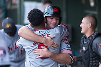 AFL East first baseman Peter Alonso (20), of the Scottsdale Scorpions and the New York Mets organization, receives a hug from second baseman Jahmai Jones (9) after hitting a home run in the first inning during the Fall Stars game at Surprise Stadium on November 3, 2018 in Surprise, Arizona. The AFL West defeated the AFL East 7-6 . (Zachary Lucy/Four Seam Images)