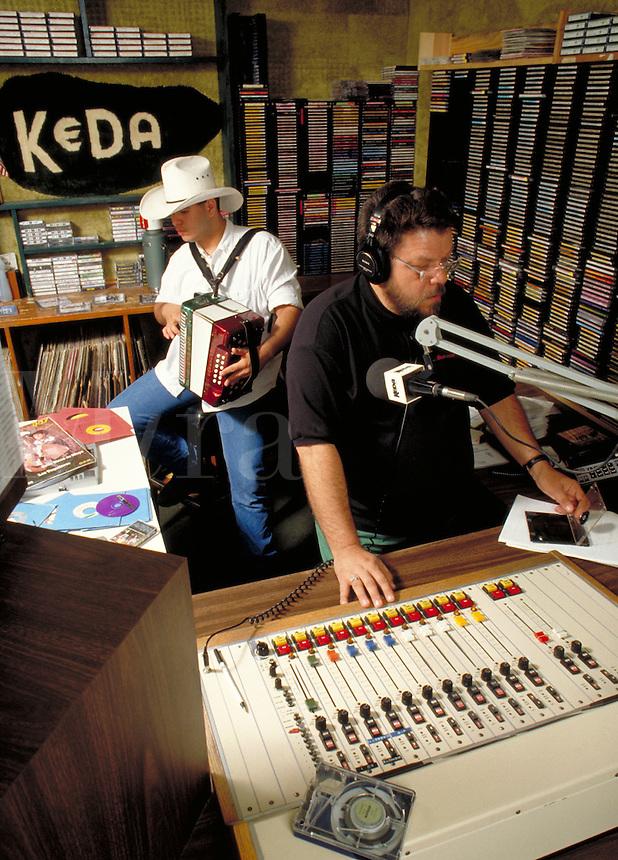 HISPANIC MUSIC (TEJANO) RADIO D.J. AND MUSICIAN BROADCAST LIVE. RADIO DISK JOCKEY AND MUSICIAN. SAN ANTONIO TEXAS.