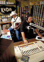 HISPANIC MUSIC (TEJANO) RADIO D.J. AND MUSICIAN BROADCAST LIVE. RADIO DISK JOCKEY AND MUSICIAN. SAN ANTONIO TEXAS.
