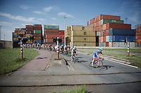 the peloton cruises through the Antwerp Harbour<br /> <br /> 90th Schaal Sels 2015
