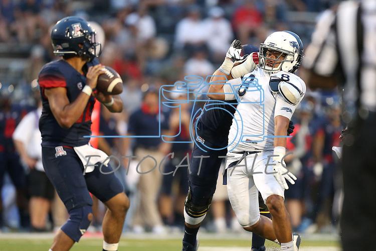 Nevada's Ian Seau pressures Arizona quarterback Anu Solomon an NCAA college football game against Arizona in Reno, Nev., on Saturday, Sept. 12, 2015. (AP Photo/Cathleen Allison)