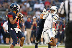 Nevada's Ian Seau pressures Arizona quarterback Anu Solomon an NCAA college football game against Arizona in Reno, Nev., on Saturday, Sept. 12, 2015. (AP Photo/Cathleen Allison)