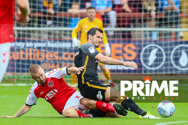 Paddy Madden of Fleetwood Town and Ryan McGowan of Bradford City during the Sky Bet League 1 match between Fleetwood Town and Bradford City at Highbury Stadium, Fleetwood, England on 1 September 2018. Photo by Thomas Gadd.