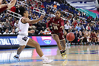 GREENSBORO, NC - MARCH 07: Marnelle Garraud #14 of Boston College passes the ball past Kai Crutchfield #3 of North Carolina State University during a game between Boston College and NC State at Greensboro Coliseum on March 07, 2020 in Greensboro, North Carolina.