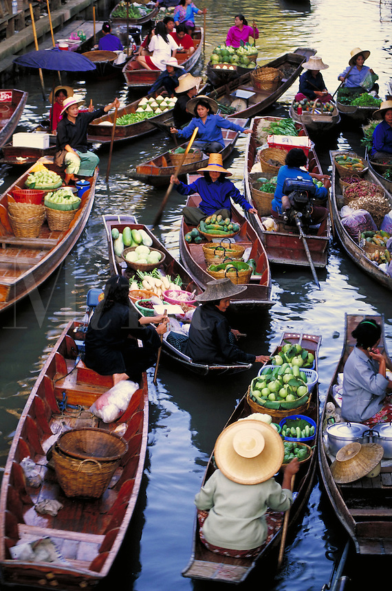 Floating market, just outside Bangkok, Thailand. Merchants in sampans. Bangkok, Thailand.