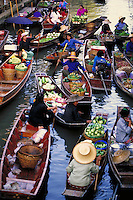 Floating market, just outside Bangkok, Thailand. Merchants in sampans. Bangkok, Thailand.