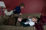 My husband horseplays with both boys, ages three and a half and nine months, in our living room.