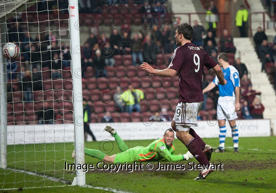 Hearts' John Sutton scores their second goal.
