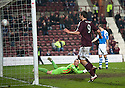 Hearts' John Sutton scores their second goal.