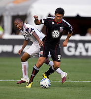 Jaime Moreno (99) of D.C. United turns away from Collen Warner (26) of Real Salt Lake during a U.S. Open Cup tournament game at RFK Stadium in Washington, DC.  D.C. United defeated Real Salt Lake, 2-1, in overtime.