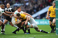 Bernard Foley of Australia is held up short of the line by George Ford of England  during the Old Mutual Wealth Series match between England and Australia at Twickenham Stadium on Saturday 3rd December 2016 (Photo by Rob Munro)