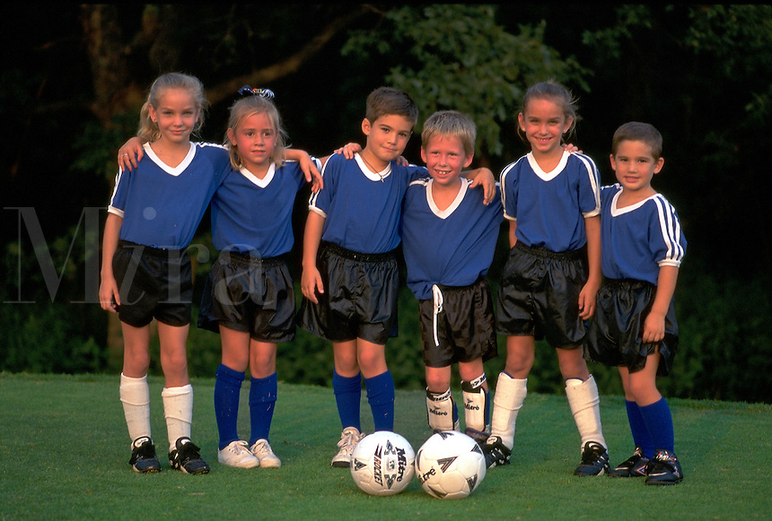 Young group of child soccer players posing for the camera. group of young soccer players.