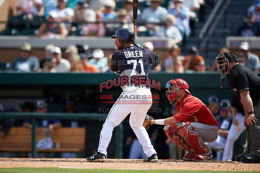 Detroit Tigers catcher Austin Green (71) at bat in front of catcher Evan Barnes (39) during an exhibition game against the Florida Southern Moccasins on February 29, 2016 at Joker Marchant Stadium in Lakeland, Florida.  Detroit defeated Florida Southern 7-2.  (Mike Janes/Four Seam Images)