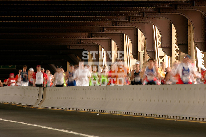 Runners from the 'middle of the pack' cross the Queensboro Bridge from Queens into Manhattan while competing in the ING New York City Marathon in New York, New York on November 4, 2007.  Martin Lel (KEN) won the men's race with a time of 2:09:04  Paula Radcliffe (GBR) won the women's race with a time of 2:23:09.