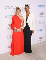 BRENTWOOD, CA - JUNE 11: Actress Rebecca Gayheart-Dane and actress/singer/songwriter Queen Latifah arrive at the 15th Annual Chrysalis Butterfly Ball at a private residence on June 11, 2016 in Brentwood, California.