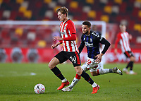 9th January 2021; Brentford Community Stadium, London, England; English FA Cup Football, Brentford FC versus Middlesbrough; Mads Roerslev of Brentford being marked by Marcus Browne of Middlesbrough