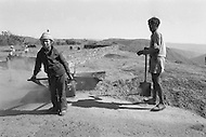 Children employed to construct a road in Meghalaya, India - Child labor as seen around the world between 1979 and 1980 – Photographer Jean Pierre Laffont, touched by the suffering of child workers, chronicled their plight in 12 countries over the course of one year.  Laffont was awarded The World Press Award and Madeline Ross Award among many others for his work.