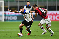 Ruslan Malinovskyi of Atalanta BC and Matteo Gabbia of AC Milan compete for the ball during the Serie A football match between AC Milan and Atalanta BC at stadio Giuseppe Meazza in Milano ( Italy ), July 24th, 2020. Play resumes behind closed doors following the outbreak of the coronavirus disease. <br /> Photo Image Sport / Insidefoto