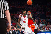 NEW YORK, NY - Sunday December 13, 2015: DaJuan Coleman (#32) of Syracuse and Yankuba Sima (#35) of St. John's fight for a ball as the two square off during the NCAA men's basketball regular season at Madison Square Garden in New York City.