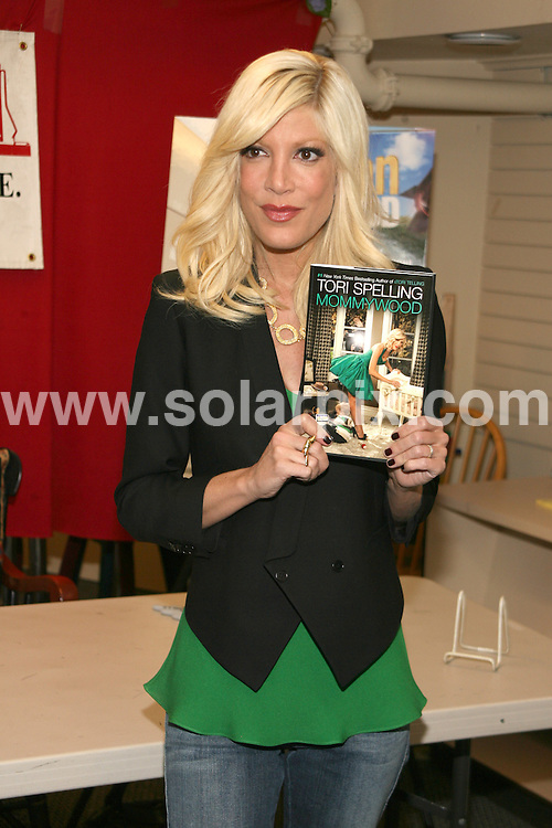 """**ALL ROUND PICTURES FROM SOLARPIX.COM**.**SYNDICATION RIGHTS FOR UK, AUSTRALIA, DENMARK, PORTUGAL, S. AFRICA, SPAIN & DUBAI (U.A.E) ONLY**.Tori Spelling's """"Mommywood"""" Book Signing at Bookends in Ridgewood, New Jersey, USA. 16 April 2009..This pic: Tori Spelling..JOB REF: 8813 PHZ (Gaboury)    DATE: 16_04_2009.**MUST CREDIT SOLARPIX.COM OR DOUBLE FEE WILL BE CHARGED**.**ONLINE USAGE FEE GBP 50.00 PER PICTURE - NOTIFICATION OF USAGE TO PHOTO @ SOLARPIX.COM**.**CALL SOLARPIX : +34 952 811 768 or LOW RATE FROM UK 0844 617 7637**"""