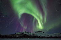 Colorful northern lights over the Brooks Range mountains in Alaska's Arctic.