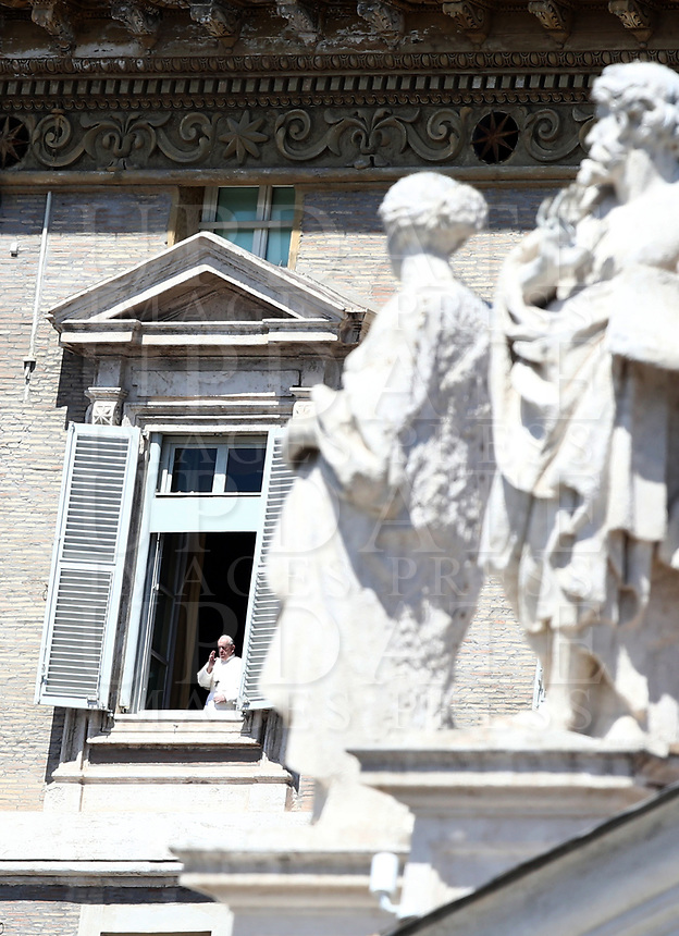 Pope Francis gives his blessing from the window of the Apostolic palace overlooking St. Peter's Square after holding a private live streamed weekly Angelus prayer from the palace's library on April 26, 2020 in the Vatican, during the lockdown aimed at curbing the spread of the COVID-19 infection, caused by the novel coronavirus.<br /> UPDATE IMAGES PRESS/Isabella Bonotto<br /> <br /> STRICTLY ONLY FOR EDITORIAL USE