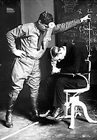Subjecting the prospective American airman to the falling test.  The sixth sense - that of equilibrium - is the function of the labyrinth of the internal ear.  March 19, 1918.  Underwood & Underwood.  (War Dept.)<br /> NARA FILE #:  165-WW-479A-23<br /> WAR & CONFLICT BOOK #:  441