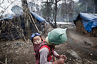 Kachin children walk around early morning at the Je Gau Pa IDP camp, located at the high mountains of northeastern Kachin State. This camp is one of the most remote temporary shelters settled under tough and poor conditions. The camp gives shelter to two thousand displaced persons from the war-torn villages close to Maiya Jang city. The KIA positions around the city have been attacked by shelling and heavy artillery during months. Fierce clashes have taken place since the ceasefire was broken out by the Burmese army last June 2011. During months the fighting were spread out along the Kachin State leaving more than 40,000 displaced persons and refugees (a conservative estimating) in accord with the humanitarian aid groups.