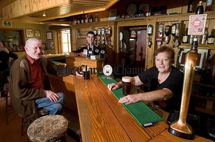 Proprietor of the Biddy Early Brewery Fionnuala Garvey pulls a pint of the Red Biddy watched by customer Ollie Lynch and barman Brian Custy. Photograph by John Kelly.