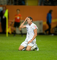 Abby Wambach (20) of the United States lies on the pitch after missing a shot on goal  during the final of the FIFA Women's World Cup at FIFA Women's World Cup Stadium in Frankfurt Germany.  Japan won the FIFA Women's World Cup on penalty kicks after tying the United States, 2-2, in extra time.
