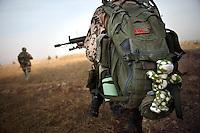Afghanistan, 26.10.2011, Nawabad. Gemeinsame Patrouille der Bundeswehr und afghanischer Armee in/um Nawabad. Die in Kundus stationierte 3. Task Force (ISAF) der Bundeswehr beginnt im Oktober 2011 die mehrtaegige Operation Orpheus. Durch Patrouillen in und um die Kleinstadt Nawabad (Dirstrikt Chahar Dareh) westlich von Kundus, Nordafghanistan, versuchen die rund 100 Infanteristen Rueckzugsorte Aufstaendischer unmoeglich zu machen. Unterstuetzt werden sie dabei durch einen Zug afghanischer Soldaten. Joint patrol of german Bundeswehr and Afghan National Army in and around Nawabad. In October 2011 Kunduz based 3.Task Force started a several days operation in and around Nawabad (District Chahar Dareh), west of Kunduz, northern Afghanistan. During the Operation Orpheus about 100 german infantry soldiers went out for patrols through the town and surrounding areas, which were expected as a retreat zone of insurgents. A platoon of afghan soldiers supports the german forces. © Timo Vogt/Est&Ost, NO MODEL RELEASE !!