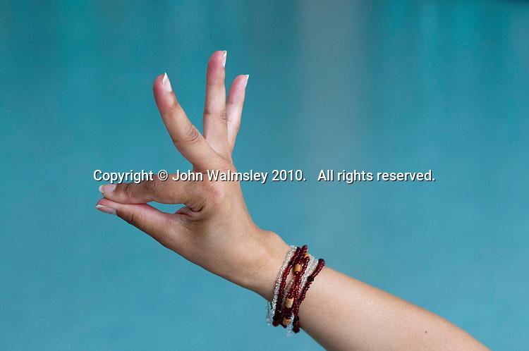 The hand position Hamsasya (swan's beak), Bollywood dance class, state primary school.