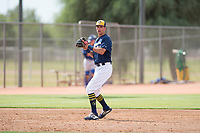 Milwaukee Brewers third baseman Chad McClanahan (72) prepares to make a throw to first base during an Instructional League game against the Los Angeles Dodgers at Maryvale Baseball Park on September 24, 2018 in Phoenix, Arizona. (Zachary Lucy/Four Seam Images)