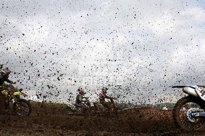 Riders compete on the course at the Unadilla Valley Sports Center in New Berlin, New York on July 16, 2006, during the AMA Toyota Motocross Championship.