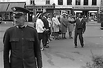 Sunday afternoon Derby town center, Derbyshire. The Salvation Arms and an Afro Caribbean Black British Christian church group take it in turn to Praise the Lord. England 1970
