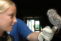 Sunday, August 2nd 2009.  Chula Vista Nature Center, San Diego, CA, USA:  Ciara Gray of Pacific Beach meets Hoots the Screech Owl at an event for the center's annual members.