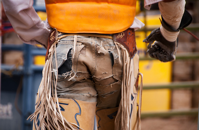 A bronc rider headed back to the chutes after being thrown before the buzzer.