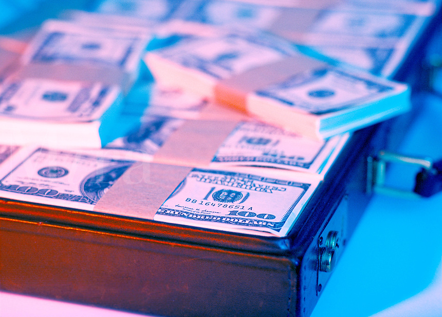 Stacks of one hundred dollar bills in a brief case