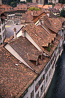 AJ1966, Switzerland, Bern, Europe, Aerial view of the roof tops of houses along the Aar River in the capital city of Bern in the Canton of Bern.